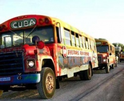 Painted buses caravaning to the border