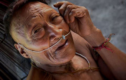 Painkillers and pens used to placate Peru's Indians as gas giants move in