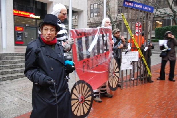 """A Message for Wells Fargo: """"Stop investing in private prisons and stop taking our homes!"""""""